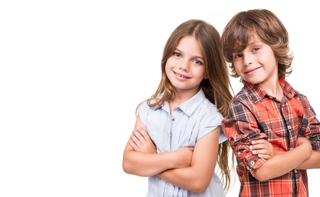 31755247 - cool little kids posing over white background