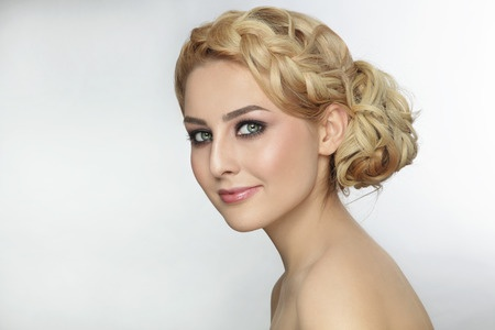 41208785 - portrait of young beautiful blonde woman with stylish prom hairdo